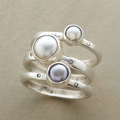 PEARL SISTERS RING TRIO -- White, gray and peacock cultured pearls, one per band, share a family resemblance, but each in this pearl sisters ring trio is unique. Exclusive set of 3 handcrafted in sterling silver. Whole sizes 5 to 9.