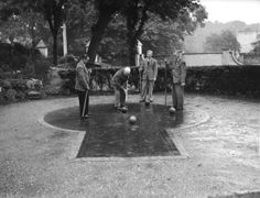 1951: The ancient game of paille maille (or pall mall) being played on the court at the Freemason's Arms, Downshire Hill, Hampstead, then the game's only venue in Britain. The game, a precursor of croquet, was introduced from France by Charles II and gave its name to what is now Pall Mall. (Photo by Reg Speller/Fox Photos/Getty Images)