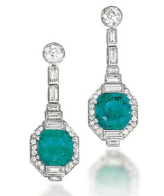 A PAIR OF ART DECO EMERALD AND DIAMOND EAR PENDANTS. Each designed as a rectangular-shaped emerald mounted within a stepped baguette-cut and circular-cut diamond surround, to the diamond line and surmount, circa 1930