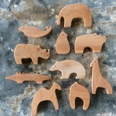 These would be fun to try to make yourself.  Piece Wooden Zoo Set