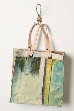 Makes me want to buy oil painting canvases from yard sales & remake them into bags.    Crafted by affixing a vintage oil painting atop a repurposed canvas pouch, this handmade, one-of-a-kind tote gives new life to a forgotten masterpiece. By Leslie Oschmann for Swarm.  Original Still Life Bag, Waterfall #anthropologie