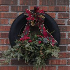 We made this tire wreath for our garage.. Love!!!