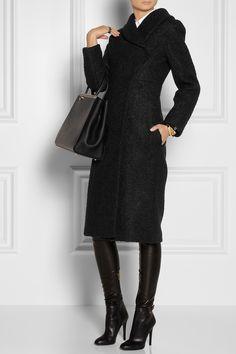 Shown here with: Marni top, Chloé cuff, Maison Martin Margiela rings, Lanvin skirt, Jimmy Choo boots, Fendi bag.
