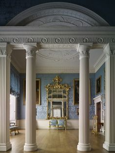 Blue sitting room with Neoclassic details.