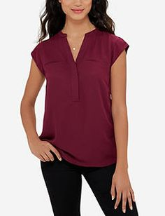 I have this blouse in both blue and green and love the fit.  This is a pretty color.