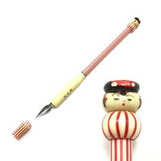 Vintage dip pen - Kokeshi doll - 1960s - Made in Japan - Red stripe 1   This pen is Kokeshi doll nib pen, one of Japanese old souvenirs made in around 1960, a pen with a fine point. The dolls face looks unique and a silhouette Humpty Dumpty. The nib of this vintage pen contains No600EF Tachikawa made in Japan. Tachikawa is Japanese company, a famous stationary maker established 1935. Their pens are excellent for drawing and of course calligraphy. Please try.  Length: 16.33cm/6.42  Condi...