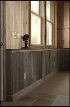 The silver gray mopboard was created from old barn wood siding