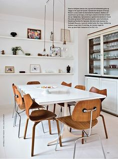 Perfect mix of Eames DCM's & Jacobsen Grand Prix chairs.