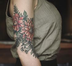 Snagged a healed photo of these dahlias, snow berries and ferns before I added to her lower arm-…