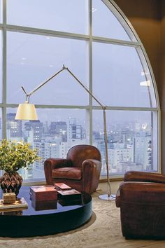 I love the view...I just want to curl up on that leather chair with a blanket and cup of coffee and read a good book!