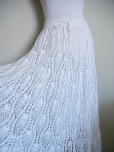 This beautifully Handmade Bohemian Crochet Skirt is made in pure white cotton. The skirt is fully crocheted, and it has a draping circular form.
