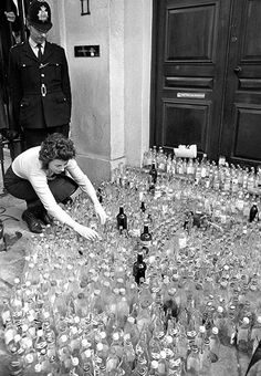 May 1971: Friends of the Earth (FoE) member Ann Davidson, of Sutherland, Scotland, places an empty bottle among 2,000 outside the headquarters of Schweppes Ltd. FoE was protesting against bottles being dumped in the countrysidePhotograph: PA/PA Archive