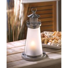 Brighten your evening with a cheery seaside glow; just add a votive inside this miniature lighthouse and enjoy the ambiance! Quaint metal sculpture makes a pretty display, even during the day. Candle