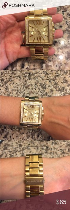 Gold and silver Michael Kors watch Gold and silver Michael Kors watch. This watch has a few scratches on the bottom of the band and needs a new battery but it still looks great and works KORS Michael Kors Accessories Watches