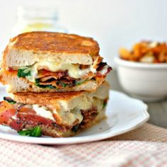 Filled with a fried egg, crispy pancetta, havarti cheese and a bit of arugula, this Breakfast Grilled Cheese Sandwich is hearty, full of flavor, and easy to take on the go!