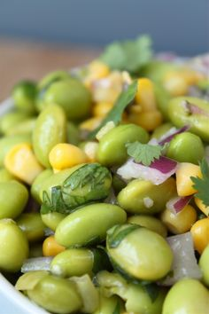 An easy, fresh, perfect summer salad! edamame, balsamic salad, corn, red onion... Mmm. Need to leave out the cilantro