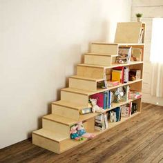 Bookshelves in the shape of a staircase, with a seat at the top.  Created by Shawn Soh (in Korea.)