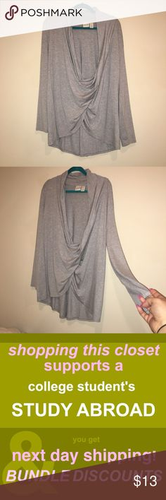 Chico's Long Sleeve Grey Scoop Top Super trendy! In perfect condition. Chico's size 2  My low prices are due to the fact that I am studying abroad this semester and I need to get EVERYTHING SOLD ASAP!   I will ship within 1-2 business days with tracking.   I have a generous bundle discount if you would like to use the bundle feature.   Shop with the thought of supporting a college student! 👩‍🎓 Chico's Tops Tees - Long Sleeve
