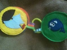 """Tiny Quiet book from felt, good idea for """"binding""""it by using ribbon loops and a toy ring."""