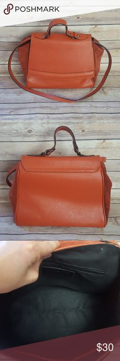 "Innue Orange Leather Shoulder Bag Beautiful Innue burnt orange leather shoulder bag with suede side panels and black cloth interior. Handbag handle and clasp closure. 1 interior zipper and 2 interior slip pockets. In great pre-owned condition - some minor wear on suede side panels (see photo). 10.5"" L x 9.5"" H x 4.25 W Strap drop: 17.5"" (not adjustable) Genuine leather made in Italy   No trades accepted  Open to reasonable offers  Bundle 3+ and get 15% off Follow us @mirror.image.trends…"