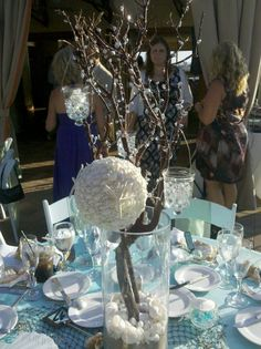 manzanita branch centerpiece at my cousin's beach theme wedding.  also one of the bridesmaid's shell/starfish bouquets