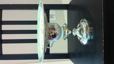 Our vintage, recycled cake stand for our wedding! An old candle stick holder, an old tea cup and a pretty china plate!