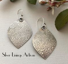 Love the lotus petal shape of these sterling silver earrings, always beautiful and timeless. I have hand cut each piece from the sterling silver textured sheet, soldered a little ring at the top of each and added hand fabricated ear wires using traditional metal smith techniques,