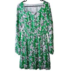 """Gorgeous Forever 21 Green Floral Dress Sz L This beautiful dress features a flows chiffon like fabric in a green, black, & white floral print. It has a stretch waist & pleated skirt. Long sleeves. Never worn & in mint condition. May fit a size medium best for a roomier fit. Measurements: 33"""" around from shoulder to shoulder, 41"""" around bust, & 27"""" waist + added stretch. Should hit at knee length or above depending how tall you are. Forever 21 Dresses Midi"""