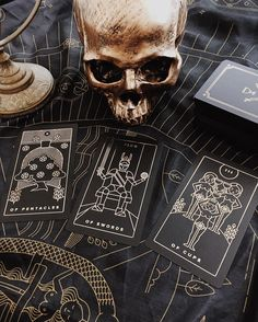 A gold foil on black plastic tarot deck. Independently published. Comes with companion app to learn tarot with ease. Magic witchcraft and tarot at Labyrinthos Academy. Independently designed and printed tarot decks and tarot apps for learning tarot on the go. For tarot beginners and everyone interested in witchcraft wicca spells mysticism occult magick tarot reading paganism indie tarot deck unique tarot deck and more.
