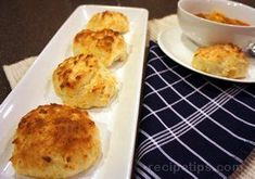 Ingredients included in this recipe are biscuit mix, shredded cheddar cheese, milk, butter.
