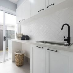 SPLASHBACK A white textured overlay to bring the hamptons to life in the laundry. Also admire the matte black tapware and handles for a a bold yet beautiful contrast. Laundry Room Tile, Laundry Nook, Room Tiles, Small Laundry, Laundry Cupboard, White Laundry Rooms, Laundry Cabinets, Laundry Baskets, Laundry Storage