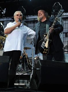 George Jones (left) makes a surprise appearance during John Anderson's set at the 2009 BamaJam Music and Arts Festival on June 4, 2009, in Enterprise, Ala. [Rick Diamond -Getty Images]