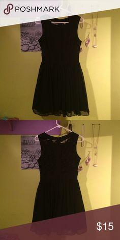 Pretty black dress Knee length black dress with tulle, lace detailing on the back. B.Smart Dresses Midi