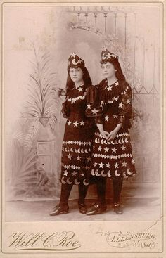 2 girls in stars and moon dresses by Roe of Ellensburg, Washington
