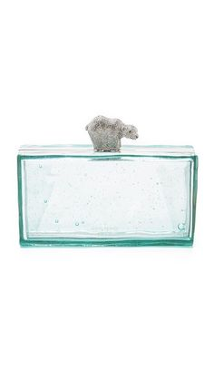 A hardshell Kate Spade New York clutch in translucent resin, accented with a crystal-encrusted, polar bear-shaped top lock. Unlined interior. Dust bag included. Kate Spade New York Polar Bear Clutch