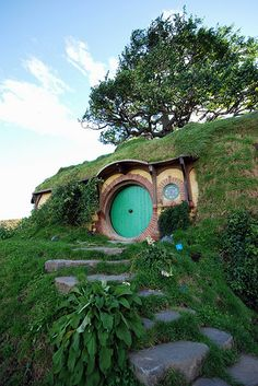 Hobbiton New Zealand (been there!) I would love to build little Hobbit holes around my garden fence for the Grandies to play in. How awesome would that be for them. Oh we'll I'll just keep dreaming!