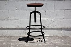 HEIGHT-ADJUSTABLE METAL & WALNUT BARSTOOLSlender, yet solid height-adjustable barstool. Powder-coated metal frame with dark walnut wooden top provide a stylish industrial-modern kitchen counter or bar stool.Available in: black metal frame with walnut seat-top.Product Size L*W*H/seat height (cm): 38*38*66-87