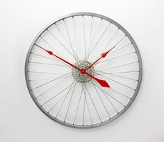 Nothing compares to the simple pleasure of riding a bike, the wind against your face, the landscape whizzing by... we wish we could bottle up the feeling that comes from riding (wed be rich if we could!). Instead here at Tread & Pedals we have for you a magnificent clock, made from a recycled bicycle wheel and gears that will remind you of cycling and the joy it brings. Itll even let you know when its riding time.  Not only does it tell the time, but as its made from carefully selected…