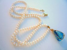 Natural Freshwater Pearl long necklace with hand wrapped Aqua Aura Crystal Quartz pendant. Diy Necklace, Gemstone Necklace, Handmade Art, Handmade Jewelry, Moonstone Jewelry, Freshwater Pearl Necklaces, Crystals And Gemstones, Quartz Crystal, Jewelry Ideas