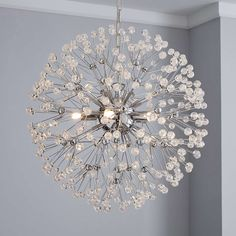 Crafted in a dandelion-inspired spherical design, this contemporary ceiling light fitting features clear acrylic beads and a chrome finish.