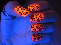 Glow-in-the-dark leopard nails