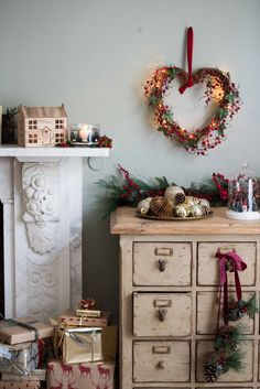 Gorgeous ornaments like this wooden house, heart-shaped wreath and glass dome festive scene are perfect for decorating your home this Christmas if you're going for a traditional feel. Go that extra mile and decorate a chest of drawers with deer-shaped doorknobs to maximize that festive feel. All of these items, and much more, are available now @Sainsburys new Winter Cottage collection. #sainsburyshome #sponsored http://trib.al/vNawctY