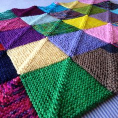 memory blanket by Georgie Hallam  Free knitting tutorial on Ravelry - modular mitered square throw, great for destashing!