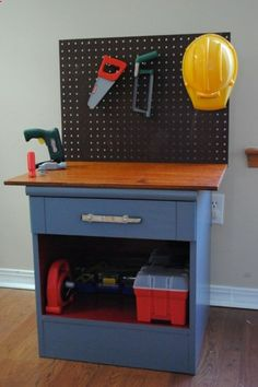 Toy Workbench from a Nightstand ~ This darling workbench was made from a nightstand picked up at a thrift store for $3! For that price, you could buy a set of play tools to go with it and youd have a perfect birthday or Christmas gift for the little builder in you life. (I even have an old nightstand!)