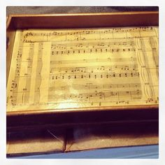 vanity tray idea. sheet music stained w/ tea bags then mod podged.