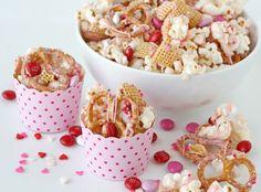 For a V-Day snack mix, mix together M&M's, sprinkles, pretzels, and popcorn.