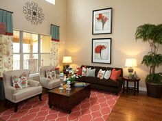 A coral-colored rug pulls together the design in this living room, uniting the pops of color found in the curtains, artwork and pillows. The neutral chairs and sofa blend into the background and let the coral and turquoise elements shine.