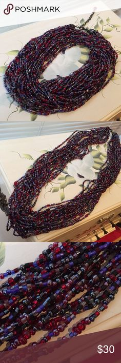 """Joan Rivers multi strand necklace Beautiful deer shades of red, purples, gray, and black multi strands. Gunmetal lobster claw clasp. Necklace about 35"""" and comes with 3"""" extender.  This can be twisted like a torsade, worn draped and long, or doubled for a really chic look. Smoke and pet free home. Joan Rivers Jewelry Necklaces"""