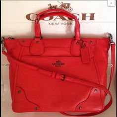 """NWT COACH LEATHER MICKIE CROSSBODY SATCHEL WoW!!!  This is a true beauty!!!  NWT Coach Leather Mickie Satchel. MSRP $450. Awesome smell of leather. The color is called """"Cardinal"""" I would describe as a bright orange. BOLD. The leather is soft to the touch, 2 leather hang tags, exterior pocket with magnet closure. Zip top closure, gunmetal hardware, Coach logo on front, dual handles, detachable, adjustable strap for shoulder or crossbody. Fabric interior (same color) zip pocket, 2 slip…"""