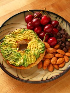 Whole grain bagel with mashed avocado, fresh grapes and almonds.
